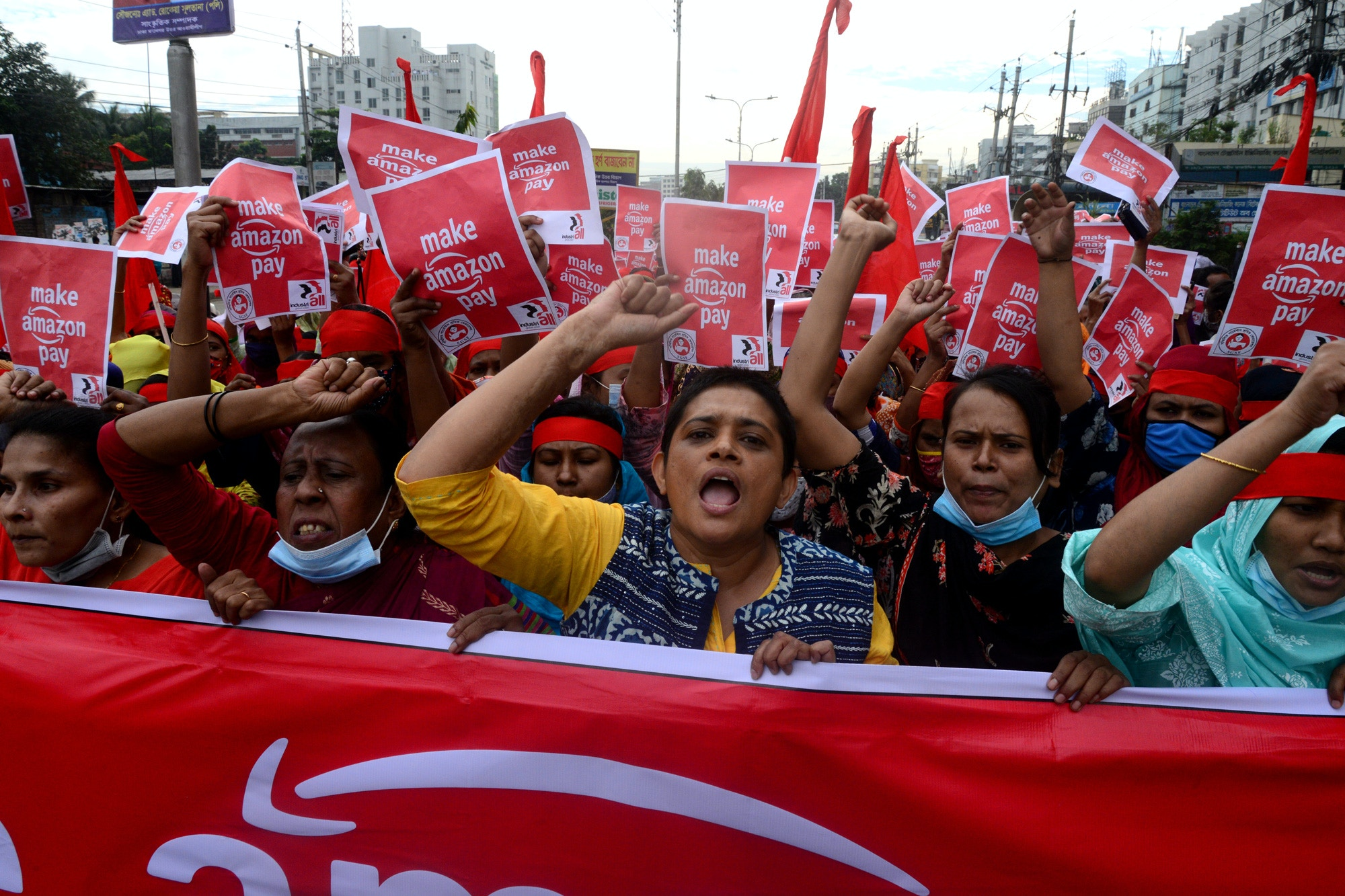 Activists of Sammilito Garments Sramik Federation (Combined Garments Workers Federation) stage a protest procession against the world's leading digital retailer Amazon.com demanding fair wages and union rights for all Amazon supply chain workers in Dhaka, Bangladesh, on November 27, 2020 (Photo by Mamunur Rashid/NurPhoto via Getty Images)