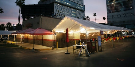 LOS ANGELES, CALIFORNIA - DECEMBER 07: A tented area which had been used for outdoor restaurant dining at Denny's stands empty on the first day of new stay-at-home orders on December 7, 2020 in Los Angeles, California. Under state order, 33 million residents of California have entered into regional shutdowns in an attempt to contain the spread of the coronavirus as ICU capacity has dipped below 15 percent in most regions of the state. Barbershops, hair and nail salons, museums, zoos, movies theaters are closed while restaurants are open for takeout or delivery only. In Los Angeles, outdoor dining was shuttered nearly two weeks ago amid a surge of coronavirus cases there. (Photo by Mario Tama/Getty Images)
