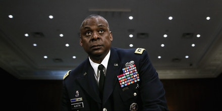 WASHINGTON, DC - SEPTEMBER 16:  Gen. Lloyd Austin III, commander of U.S. Central Command, prepares to testify before the Senate Armed Services Committee about the ongoing U.S. military operations to counter the Islamic State in Iraq and the Levant (ISIL) during a hearing in the Dirksen Senate Office Building on Capitol Hill September 16, 2015 in Washington, DC. Austin said that slow progress was still being made against ISIL but there have been setbacks, including the ambush of U.S.-trained fighters in Syria and the buildup of Russian forces in the country.  (Photo by Chip Somodevilla/Getty Images)