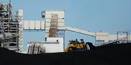 A bulldozer drives on a coal mound at the NRG Energy Inc. WA Parish generating station in Thompsons, Texas, U.S., on Thursday, Feb. 16, 2017. The plant is home to the Petra Nova Carbon Capture Project, a joint venture between NRG Energy and JX Nippon Oil & Gas Exploration Corp., which reportedly captures and repurposes more than 90% of its own Co2 emissions. Photographer: Luke Sharrett/Bloomberg via Getty Images