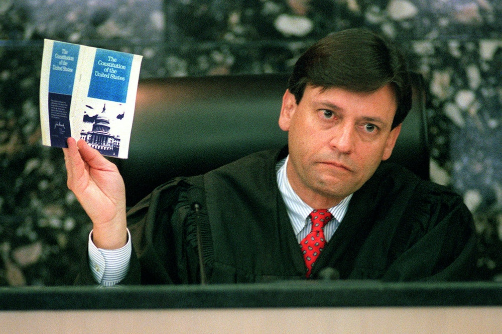 Palm Beach County Circuit Court Judge Jorge Labarga shows the booklet about the Constitution of the United States that he received while in law school, and from which he quoted during court, November 17, 2000. Labarga heard arguments from various attorneys representing the Florida Democratic Party, the Palm Beach County Canvassing Board, George W. Bush and Florida voters, in order to determine whether there is a constitutional basis for a revote in Palm Beach County.  RCS - RP2DRHYZOIAB