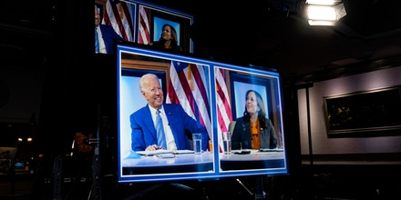 President-elect Joe Biden and Vice President-elect Kamala Harris are seen on a monitor screen as they listen during a meeting with Biden's COVID-19 advisory council, Monday, Nov. 9, 2020, at The Queen theater in Wilmington, Del. (AP Photo/Carolyn Kaster)