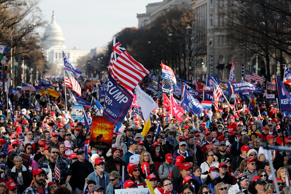 Trump supporters gather for the Stop the Steal rally at Freedom Plaza in Washington on December 12, 2020. Photo by Yuri Gripas/Abaca/Sipa USA(Sipa via AP Images)
