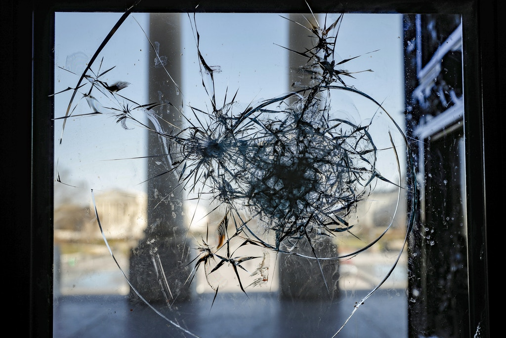 A broken window is seen after a rally at the U.S. Capitol Building in Washington, the United States. Thousands of Trump's supporters violently stormed the US Capitol on Wednesday in a bid to prevent Congress from certifying the election results. The attack came after Trump urged his supporters to keep fighting to overturn the election results. Stringer / Sputnik  via AP