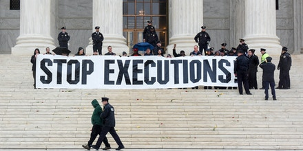 WASHINGTON, DC JANUARY 17: One by one, a group of demonstrators are arrested on the steps of the US Supreme Court as members of the anti-death penalty Abolitionist Action Committee and many faith leaders stage a demonstration at the U.S. Supreme Court on Tuesday, January 17, 2017. The demonstration is to mark the 40th anniversary of the first execution under contemporary laws (Photo by Jahi Chikwendiu/The Washington Post via Getty Images)
