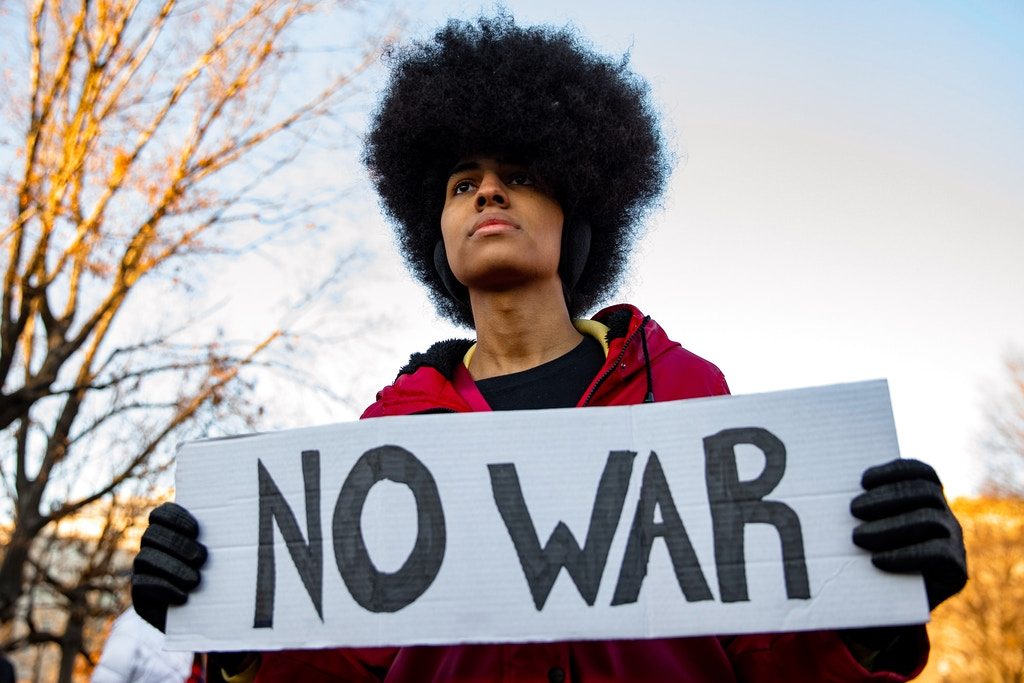 WASHINGTON, DC - JANUARY 08: Nora, 24, from Washington, D.C., stands outside of the White House on January 8, 2020 in Washington, DC. Protesters have gathered to speak out against escalation towards Iran following the U.S. killing of Iranian General Qasem Soleimani and Iran's retaliatory missile attacks against two U.S.military bases in Iraq. (Photo by Samuel Corum/Getty Images)