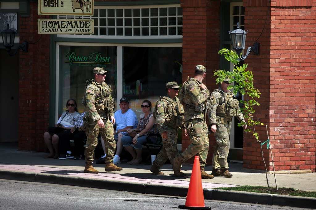 NASHVILLE, INDIANA, UNITED STATES - 2020/06/20: Members of the Indiana National Guard patrol the streets during the demonstration. Protest in solidarity with Black Lives Matter for Racial Justice in downtown Nashville. (Photo by Jeremy Hogan/SOPA Images/LightRocket via Getty Images)