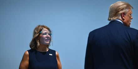 US President Donald Trump (R) is greeted by the Chairwoman of the Arizona Republican Party Kelli Ward as he arrives to deliver remarks on immigration and border security at the international airport in Yuma, Arizona on August 18, 2020. (Photo by Brendan Smialowski / AFP) (Photo by BRENDAN SMIALOWSKI/AFP via Getty Images)