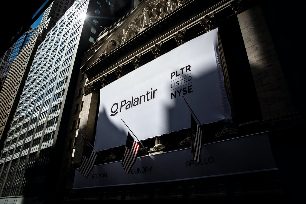 A banner displays Palantir Technologies Inc. signage during the company's initial public offering (IPO) in front of the New York Stock Exchange (NYSE) in New York, U.S., on Wednesday, Sept. 30, 2020. Shares of Palantir Technologies, a data mining company co-founded by technology billionaire Peter Thiel, opened trading today on the New York Stock Exchange at $10 after the company sold shares to investors in a direct offering. Photographer: Michael Nagle/Bloomberg via Getty Images