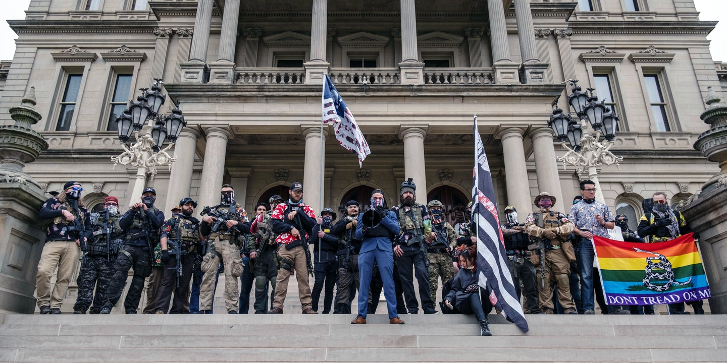 "Armed anti-government extremists who call themselves ""boogaloo bois"" hold a rally at Michigan State Capitol on Oct. 17, 2020, in Lansing, Mich."