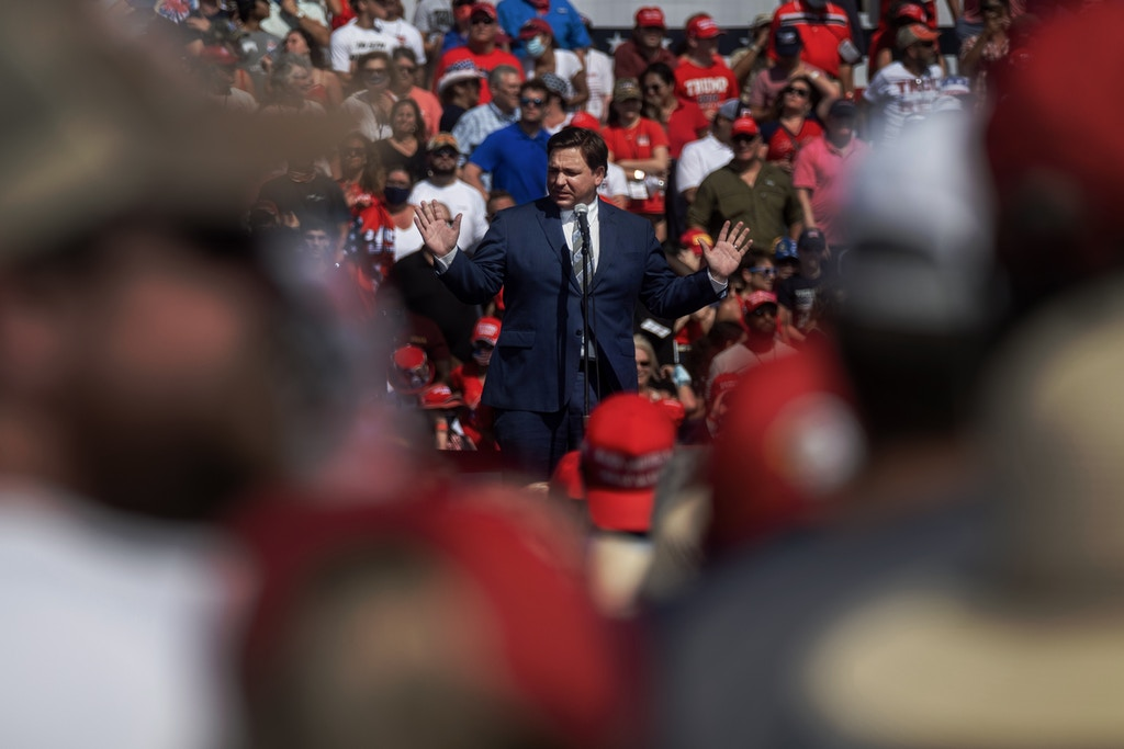 Florida Governor Ron DeSantis speaks to the crowd before a Make America Great Again campaign rally in Tampa, Florida on October 29, 2020. (Photo by Ricardo ARDUENGO / AFP) (Photo by RICARDO ARDUENGO/AFP via Getty Images)