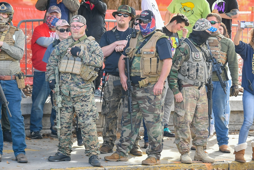 ATLANTA, GA - DECEMBER 12:  Armed militia members watch members of Antifa during a Stop The Steal protest at the Georgia State Capitol on December 12th, 2020 in Atlanta, GA. (Photo by Rich von Biberstein/Icon Sportswire)