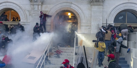 WASHINGTON DC, DISTRICT OF COLUMBIA, UNITED STATES - 2021/01/06: Police use tear gas around Capitol building where pro-Trump supporters riot and breached the Capitol. Rioters broke windows and breached the Capitol building in an attempt to overthrow the results of the 2020 election. Police used batons and tear gas grenades to eventually disperse the crowd. Rioters used metal bars and tear gas as well against the police. (Photo by Lev Radin/Pacific Press/LightRocket via Getty Images)