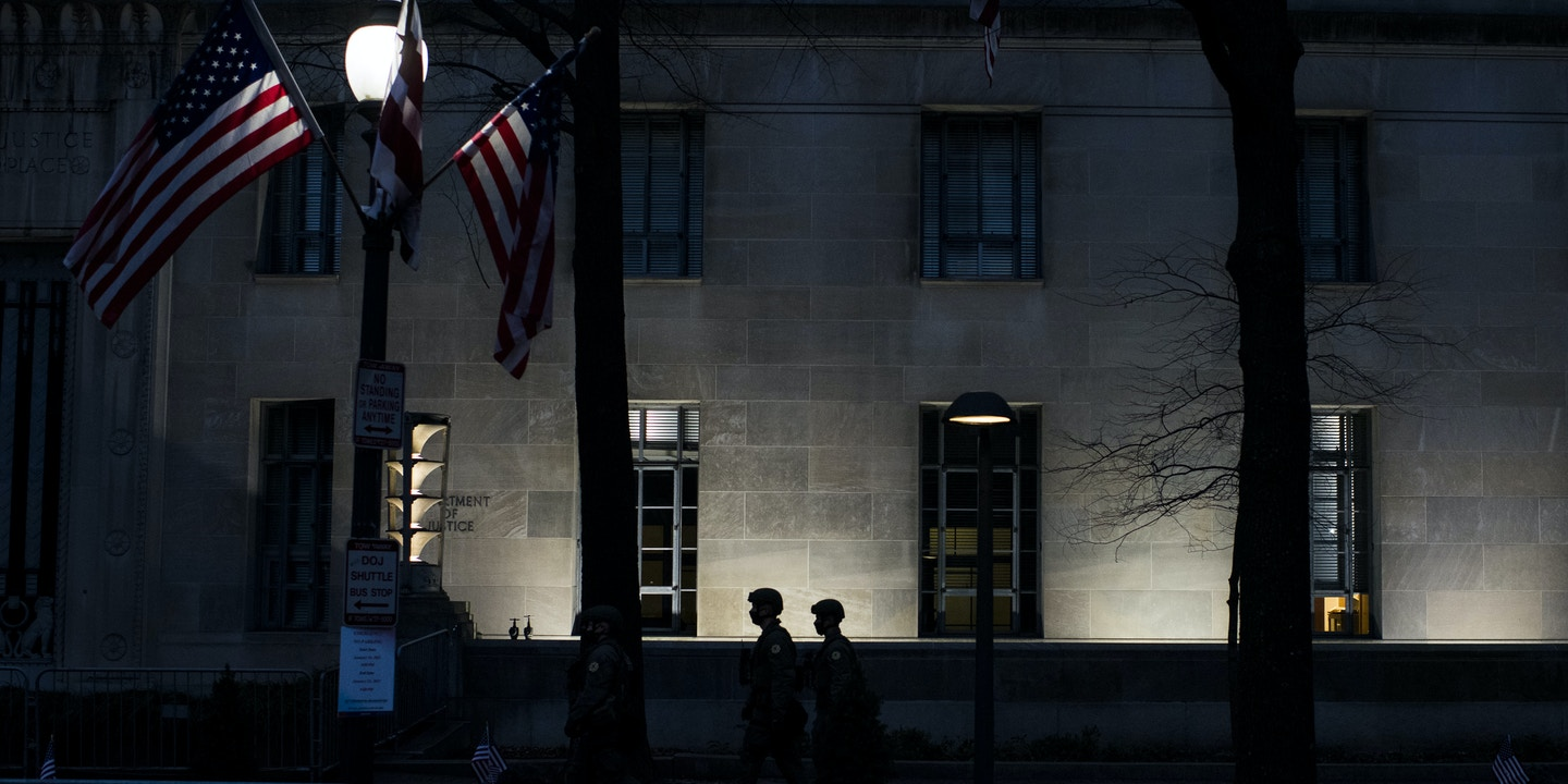 U.S. Capitol Police officers walk by the Department of Justice (DOJ) building in Washington, D.C., U.S., on Sunday, Jan. 17, 2021. A bulletin this week from the FBI and other agencies warned that extremists may exploit the aftermath of the Capitol breach by conducting attacks to destabilize and force a larger conflict in the U.S. Photographer: Pete Kiehart/Bloomberg via Getty Images