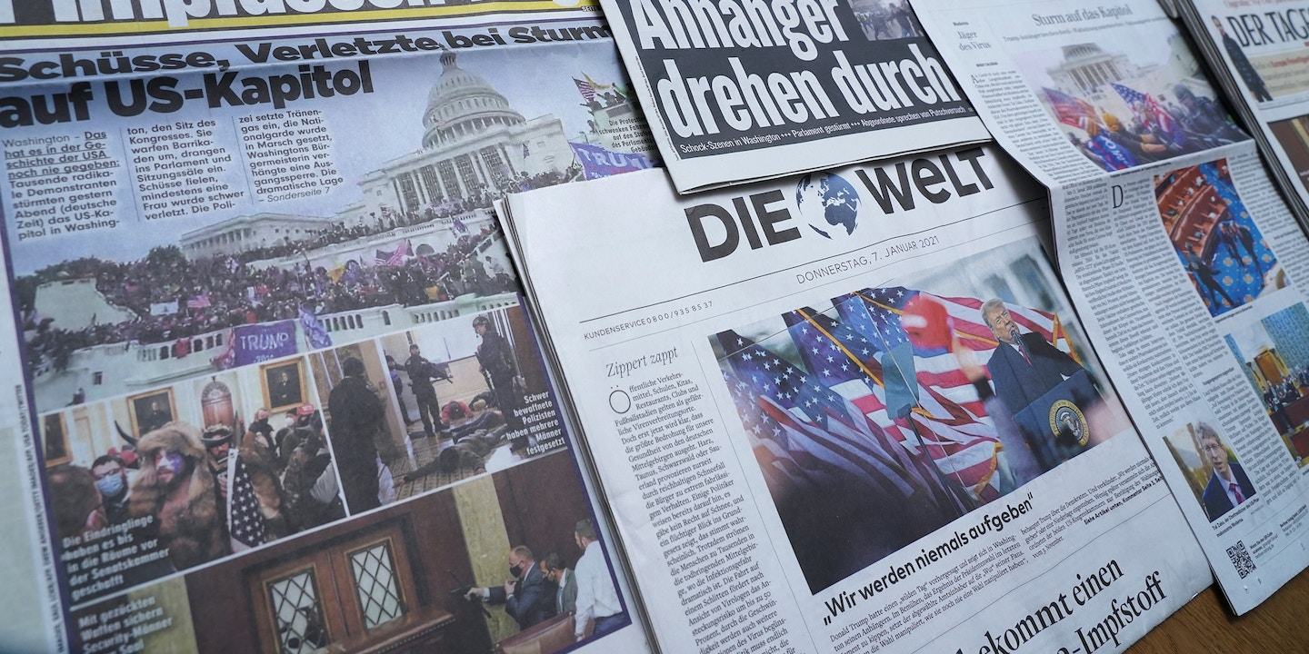 BERLIN, GERMANY - JANUARY 07: In this photo illustration, Newspaper front pages show yesterday's storming by supporters of U.S. President Donald Trump of the U.S. Capitol on January 7, 2021 in Berlin, Germany. Politicians across the world have reacted with shock and dismay at the events in Washington, D.C., in which Trump supporters, egged on by Trump at a rally nearby earlier in the day, converged on the Capitol, broke into the building, challenged law enforcement officers and forced lawmakers, who were debating the electoral college count to certify the U.S. presidential victory of Joe Biden, to flee to safety. (Photo by Sean Gallup/Getty Images)