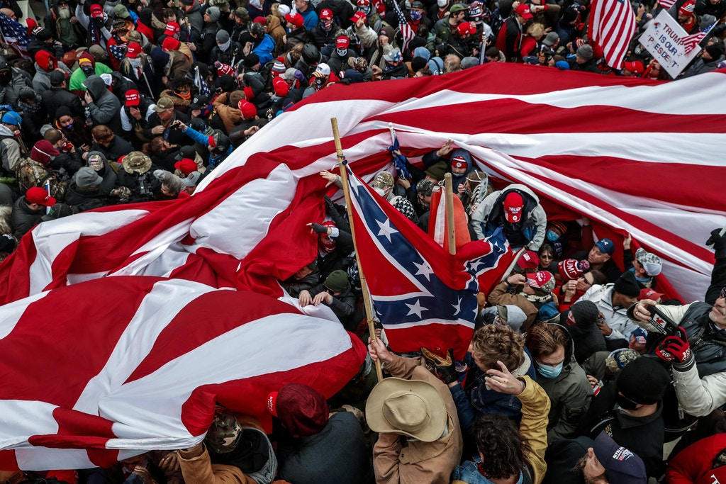 Protesters wave American and Confederate flags during clashes with Capitol police at a rally to contest the certification of the 2020 U.S. presidential election results by the U.S. Congress, at the U.S. Capitol Building in Washington, U.S, January 6, 2021. REUTERS/Shannon Stapleton - RC2N2L9I7JHI