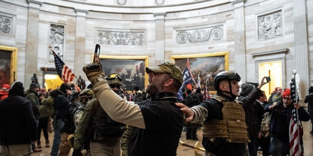 Supporters of US President Donald Trump protest inside the US Capitol on January 6, 2021, in Washington, DC. - Demonstrators breeched security and entered the Capitol as Congress debated the a 2020 presidential election Electoral Vote Certification. (Photo by SAUL LOEB / AFP) (Photo by SAUL LOEB/AFP via Getty Images)