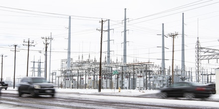 Motorist on County Road West drive past a power station Tuesday, Feb. 16, 2021, in Odessa, Texas.   Many residents and businesses were left without power following a weekend of below freezing temperatures in Midland and Odessa. (AP Photo|Odessa American, Jacob Ford)