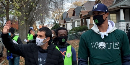 Milwaukee Bucks senior vice president Alex Lasry, left, and guard George Hill walk through a Milwaukee neighborhood during a voter canvassing effort Saturday, Oct. 24, 2020.
