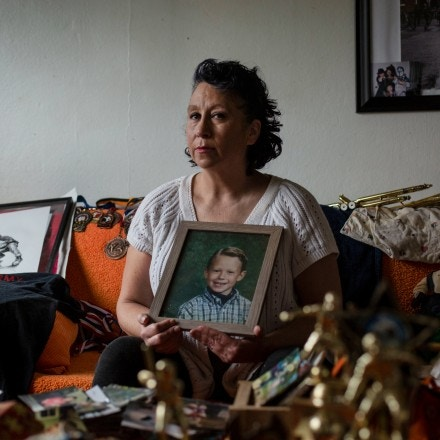 Laura Kealiher holds a childhood photo of her son Sean Kealiher at her home in Portland, Oregon, on January 30, 2021. Sean was a Portland activist killed in 2019 when he was 23. Brooke Herbert for The Intercept