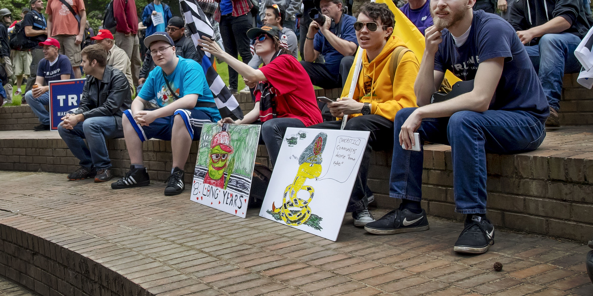 "Members of a pro-Trump student group at Portland State University listen to speakers at the ""Trump Free Speech Rally"" in Portland, Ore., on June 4, 2017."