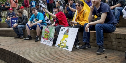 """Members of a pro-Trump student group at Portland State University listen to speakers at the """"Trump Free Speech Rally"""" in Portland, Ore., on June 4, 2017."""