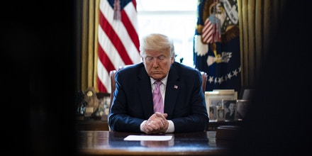 WASHINGTON, DC - APRIL 10: President Donald Trump bows his head during a Easter blessing by Bishop Harry Jackson, senior pastor at Hope Christian Church in Beltsville, Md., in the Oval Office of the White House on  April 10, 2020 in Washington, DC.The Trump adminstration is stressing the need for physical distancing over the Easter weekend. (Photo by Al Drago - Pool/Getty Images)