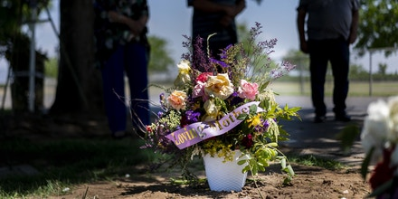 DINUBA, CALIFORNIA - MAY 3, 2020:  On Good Friday Hortensia Sosa died from COVID-19 while at Redwood Springs Health Center's nursing home in Visalia, her family (L-R) Olivia Sosa Lopez, Richard Sosa, and Richard Lopez,  stand at her grave mourning the  death and scorning the nursing home's poor care at Smith Mountain Cemetery in Dinuba, California Sunday May 3, 2020.  (Photo by Melina Mara/The Washington Post via Getty Images)