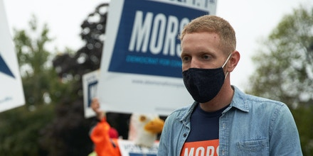 Alex Morse, mayor of Holyoke, speaks with a supporter during a campaign event in South Hadley, Massachusetts, U.S., on Aug. 29, 2020.