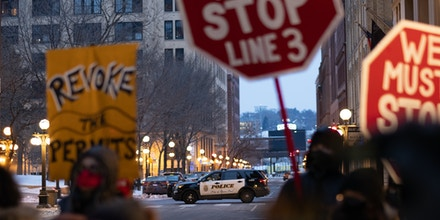 A St. Paul Police vehicle sets up a perimeter on the edge of the Line 3 protest in St. Paul, MN. January 29, 2021.