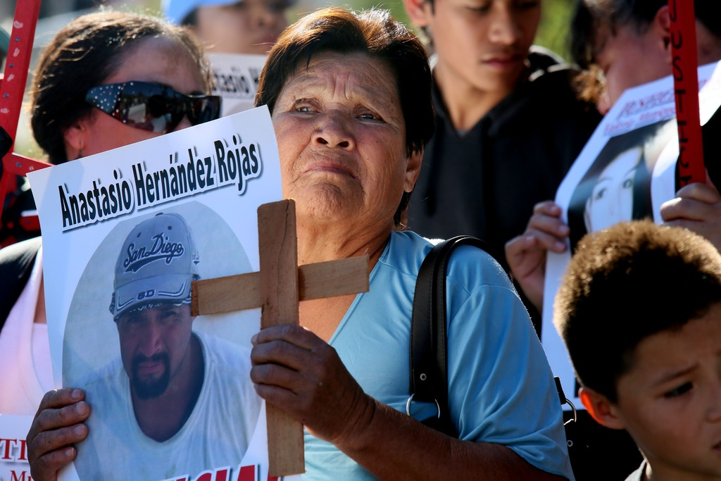 Maria de la Luz stands with a picture of her son Anastasio Hernandez Rojas, who was killed by a border Patrol agent, during a rally at the U.S.-Mexico border in San Ysidro, California on Saturday, February 23, 2013. Approximately Two hundred activists from several Latino organizations met at the border to protest several deaths and beating caused by Customs and Border Protection agents. (Photo by Sandy Huffaker/Corbis via Getty Images)