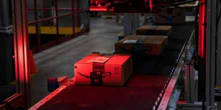 A package pass a scanner while moving along a conveyor at the Amazon.com Inc. fulfillment center in Robbinsville, New Jersey, U.S., on Thursday, June 7, 2018. Seattle-based Amazon hasn't yet announced the exact date for this year's Amazon Prime Day, the e-commerce giants big July sales promotion. Photographer: Bess Adler/Bloomberg via Getty Images