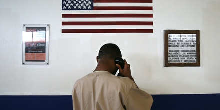 An incarcerated person makes a call from the military Veterans Unit of the Cybulski Rehabilitation Center on May 3, 2016 in Enfield, Connecticut.