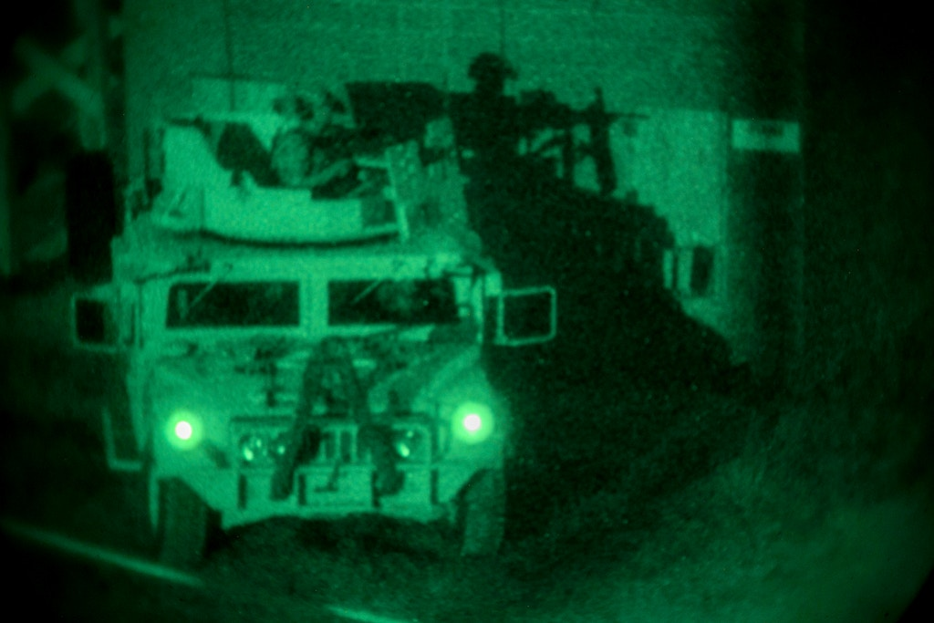 Marine Raiders assigned to 3rd Marine Raider Battalion, Marine Corps Forces Special Operations Command, execute a direct-action night raid during Training Exercise II at Marine Corps Base Camp Lejeune, July 26, 2020. The exercise gives a Marine Special Operations Team the ability to practice full-scale ground assault and demonstrate team-level proficiency, cohesion and agility for evaluators. (U.S. Marine Corps photo by Cpl. Ethan Green)