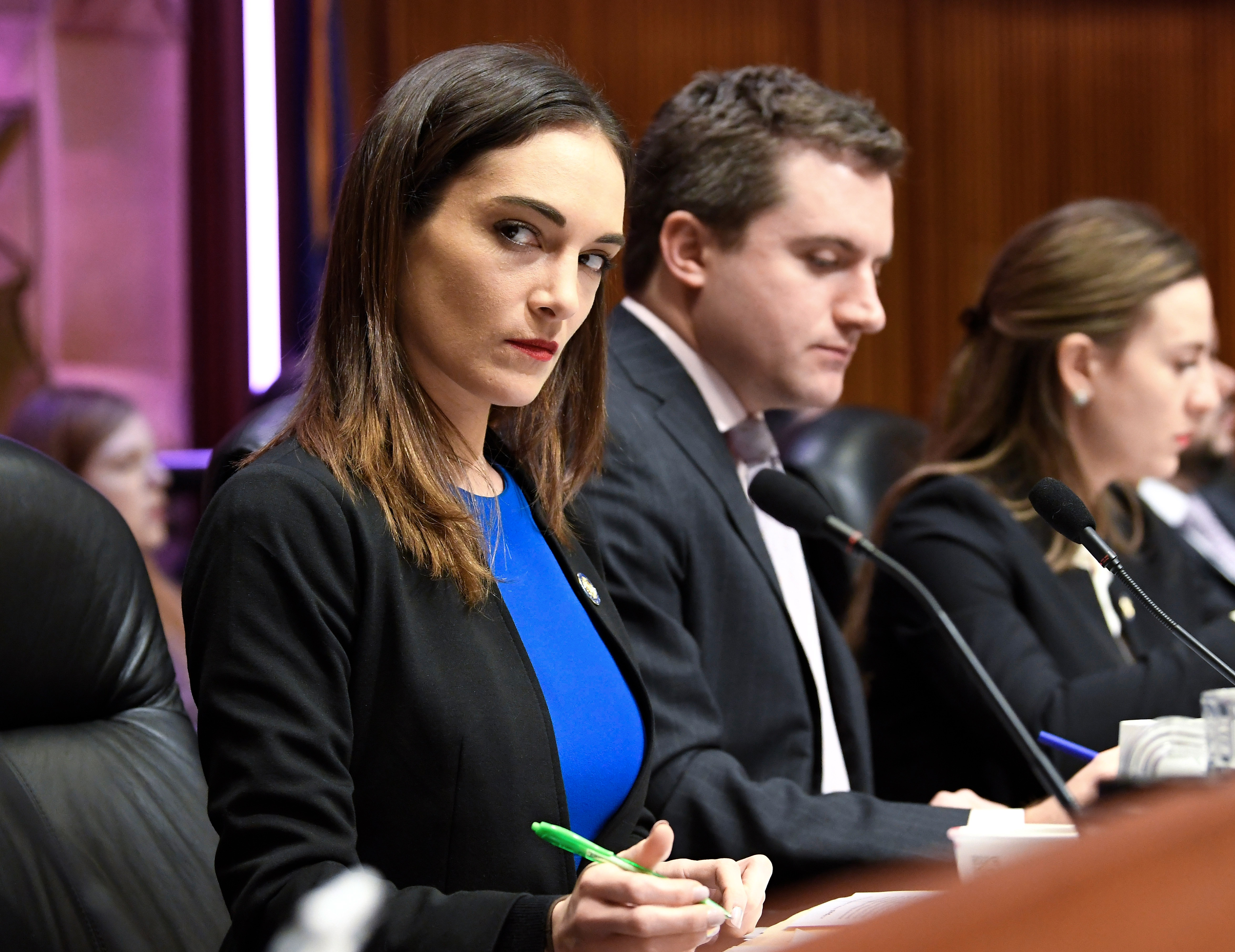 From left, New York state Senators' Julia Salazar, James Skoufis, and Alessandra Biaggi, listen as state legislators hold a public hearing on sexual harassment in the workplace Wednesday, Feb. 13, 2019, in Albany, N.Y. (AP Photo/Hans Pennink)