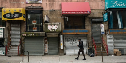 Small businesses are shuttered closed during the coronavirus epidemic in the Crown Heights neighborhood of the Brooklyn borough in New York on April 8, 2020.