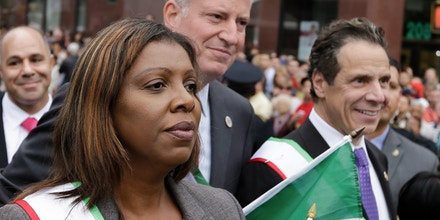 New York City Mayor Bill de Blasio, center, Gov. Andrew Cuomo, right, and New York City Public Advocate Letitia James, march together during the 88th Annual Feast of San Gennaro Grand Procession in New York on Saturday, Sept. 13, 2014. (AP Photo/Frank Franklin II)