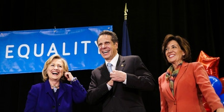 FILE- In this Oct. 23, 2014 file photo, former Secretary of State Hillary Rodham Clinton, left, New York Governor Andrew Cuomo and Lt. Governor nominee Kathy Hochul laugh on stage during a