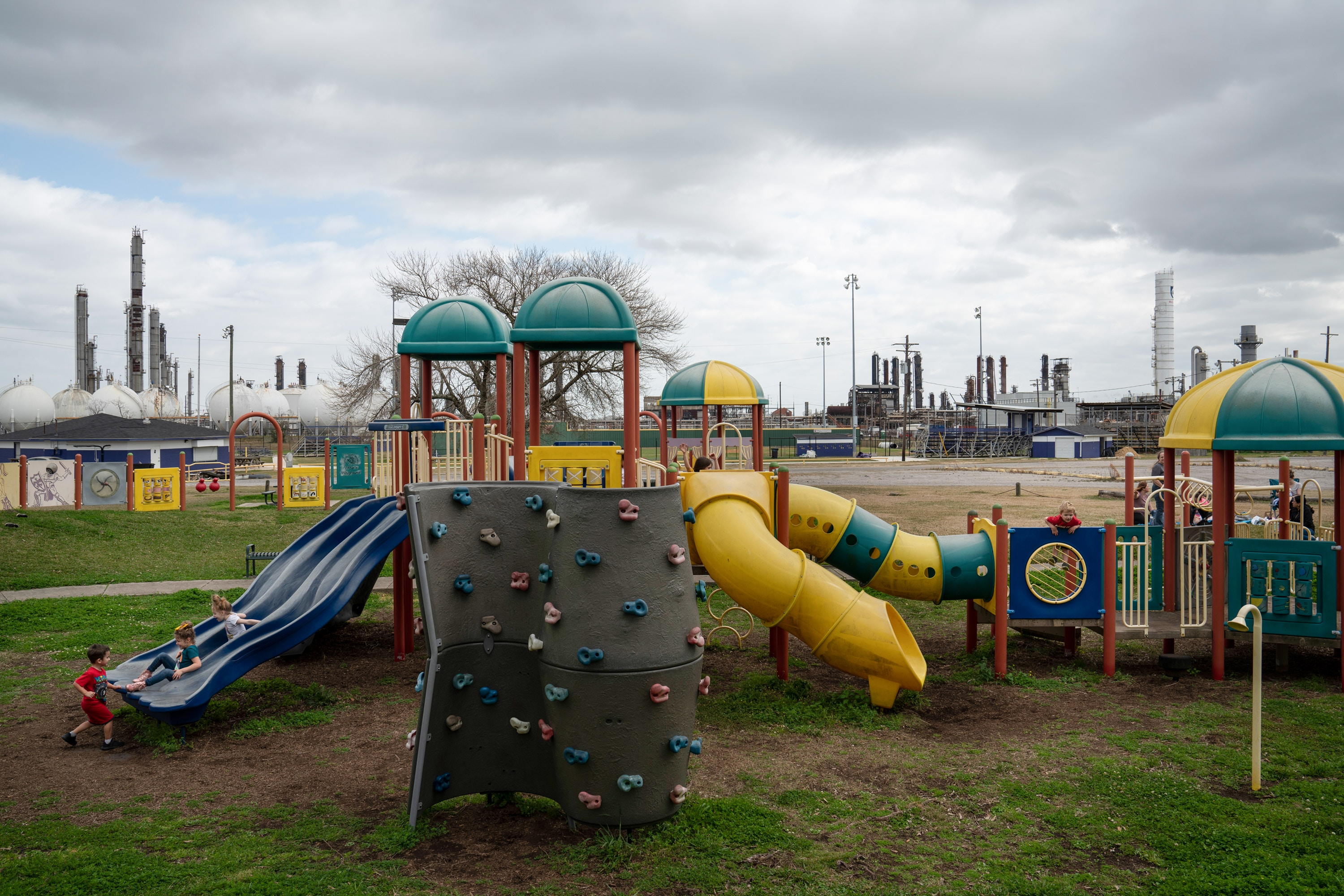 Children are seen at a playground across the TCP Group plant that exploded in late 2019 in Port Neches, Texas on Feb. 4, 2021.Verónica G. Cárdenas for The Intercept