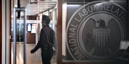 The National Labor Relations Board (NLRB) seal is reflected in a window at the headquarters in Washington, D.C., on Sept. 30, 2019.