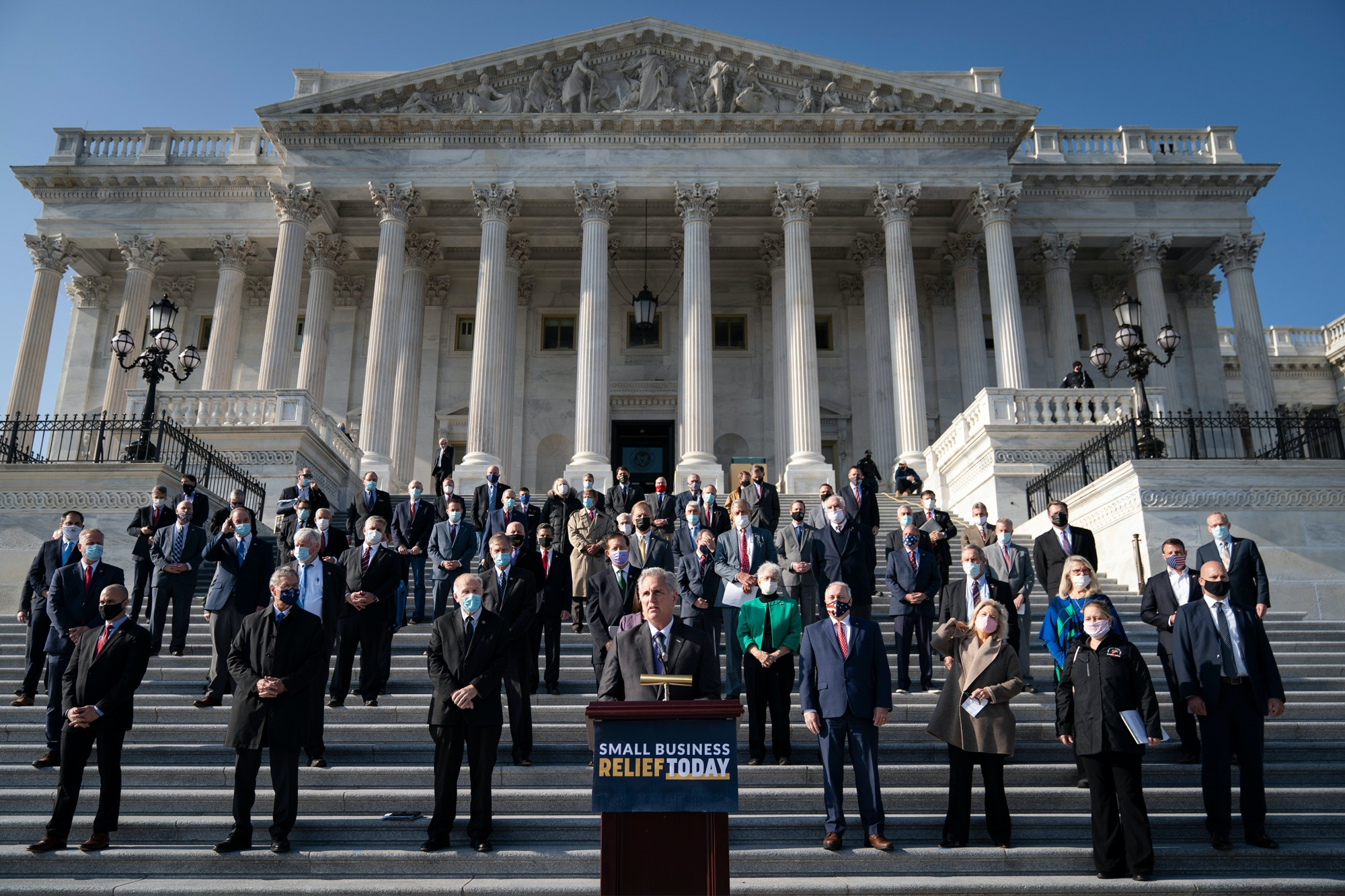 House Minority Leader Kevin McCarthy (R-CA), surrounded fellow House Republicans, speaks during a news conference outside the U.S. Capitol December 10, 2020 in Washington, DC.