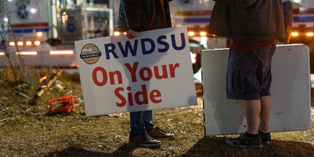 Demonstrators hold signs during a Retail, Wholesale and Department Store Union (RWDSU) held protest near the Amazon.com Inc. BHM1 Fulfillment Center in Bessemer, Alabama, U.S., on Feb. 6, 2021.