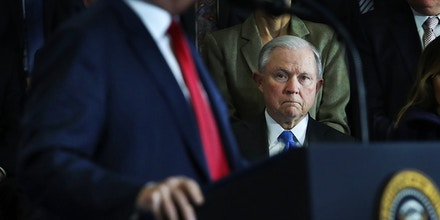 U.S. Attorney General Jeff Sessions watches as President Donald Trump, speaks to supporters, local politicians and police officers at an event at Manchester Community College on March 19, 2018 in Manchester, New Hampshire.