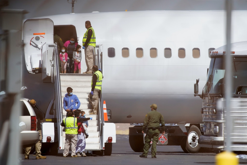 Migrants arrive on a chartered flight from Brownsville, Texas in El Paso, Texas, on March 17, 2021.