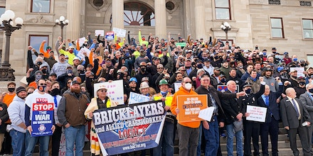 Workers from across Montana protest so-called right-to-work legislation at the state Capitol before a floor vote in the House in Helena, Mont., on March 2, 2021.
