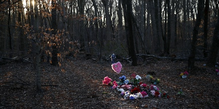 In this Jan. 28, 2019, photo, flowers adorn Anton Black's gravesite in the corner of a cemetery in Kent County, Md. Attorneys representing Black's family are asking the U.S. Justice Department to investigate the 19-year-old's September 2018 death in police custody. (AP Photo/Patrick Semansky)