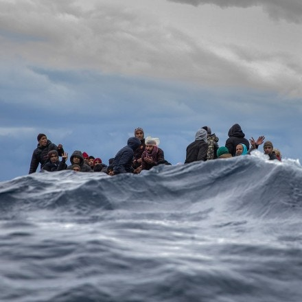 Migrants from Morocco and Bangladesh wait on an overcrowded wooden boat for aid workers from the Spanish search and rescue group Open Arms off the Libyan coast on Jan. 10, 2020. (AP Photo/Santi Palacios)