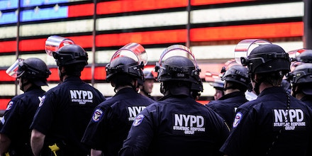 TOPSHOT - NYPD police officers watch demonstrators in Times Square on June 1, 2020, during a