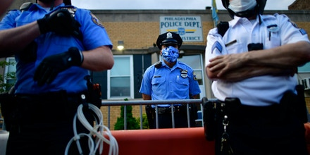 PHILADELPHIA, PA - JUNE 03: A police officer grabs for his truncheon while observing activists gathering in protest outside the 26th Precinct on June 3, 2020 in Philadelphia, Pennsylvania. Protests continue to erupt in cities throughout the country over George Floyd, the black man who died while in police custody in Minneapolis on May 25. (Photo by Mark Makela/Getty Images)