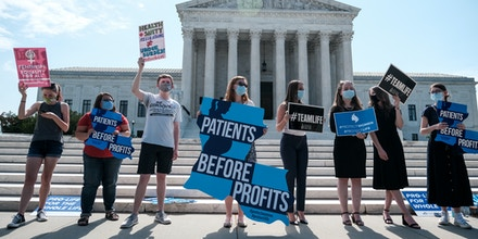 Pro-life activists stage a protest in front of the U.S. Supreme Court on June 25, 2020 in Washington, DC.